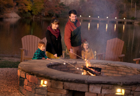 family around bonfire