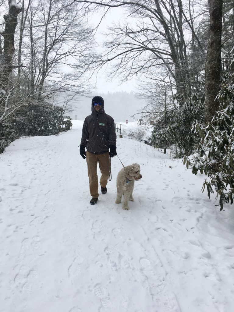 Man and dog on snowy hike